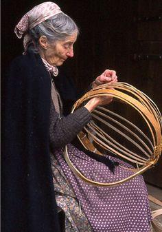 Tasha making a basket.