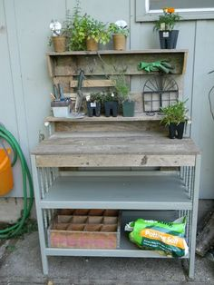 love this homemade potting bench...put together with some old boards and an old changing table...