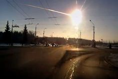 """Fireball over Chelyabinsk 2013-02-15. (Frame grab from a video by Aleksandr Ivanov) ©Mona Evans, """"Asteroid Facts for Kids) http://www.bellaonline.com/articles/art33501.asp"""