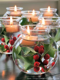 Create great small centerpieces to place down the center of a table with small vases filled with holly and floating candles.