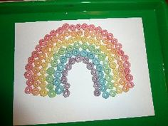 March 18, 2014. The kids used sorted Froot Loops cereal to make a Froot Loops rainbow!