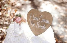 here  comes the bride wood heart sign
