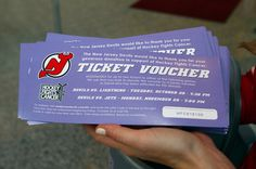 A ticket voucher for upcoming Devils games for a donation to #HockeyFightsCancer Night is displayed.