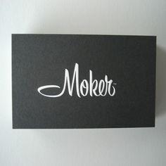 moker, logo