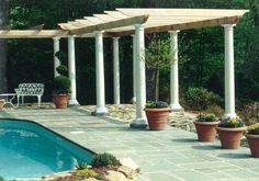 pergola covered walkway and bluestone pool patios by Matthew Giampietro of Waterfalls Fountains & Gardens Inc.