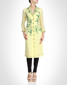 Yellow kurti with green floral embroidery. Shop Now: www.kimaya.in