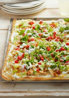 Chicken Club Pizza -- Chicken, bacon, lettuce and tomato come together for a deli fave translated into a melt, hot pizza recipe. Get all the flavors of a delicious club sandwich in every bite.