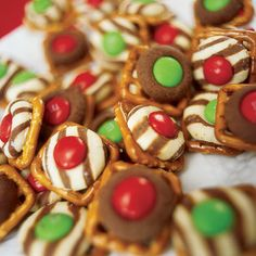 hershey kisses and hugs on square pretzels ... 5-6 minutes at 350... add M&M;'s