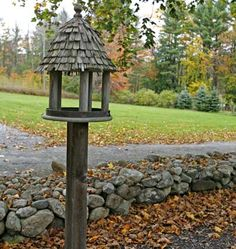 An autumnal view of a stone fence and birdhouse from an 18th century saltbox covered in the October 2013 issue of Early American Life. #stonefence #birdhouse