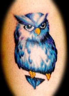 owl tattoo - nice colors and use of negative space