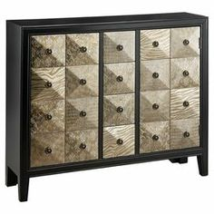 Hand-painted pyramid facings highlight this eye-catching chest. Showcasing an array of textures in a luxe metallic finish, this artful design features 2 doors and 4 drawers for stylish storage.  Product: ChestConstruction Material: Wood and metalColor: Black and beigeFeatures:  Two doors Four drawers Dimensions: 36.75'' H x 42'' W x 12'' D