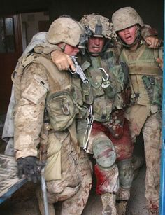 Soldiers helping a wounded comrade.