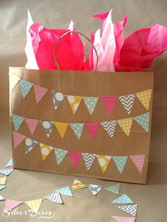 DIY Pennant Gift Bag - cut out triangles from different patterned paper and then glue on kraft bag. Easy and cute!