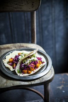 Roasted sweet potato tacos with spicy slaw and avocado