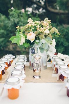 Mason or jam jars filled wtih goodies and name tag attached double as escort cards and favors. Kate Miller Photography