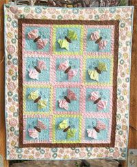 """Butterfly Kisses 3-D Quilt Pattern by Cute Quilt Patterns at KayeWood.com. This sweet quilt will have your favorite little girl floating off to sleep with the flying, dimensional butterflies!  Butterfly Kisses measures approximately 41"""" x 51"""". http://www.kayewood.com/item/Butterfly_Kisses_Quilt_Pattern/3616 $9.00"""