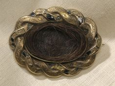 """""""This is a brooch containing a lock of Edgar Allan Poe's hair. It was given to Sarah Elmira Royster Shelton, who was Poe's adolescent sweetheart and became engaged to him shortly before his death in 1849"""""""