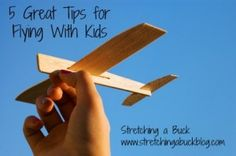 Tips for flying on an airplane with kids without going insane! Family travel tips and product recommendations.
