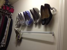 Curtain rods from Target make a shoe rack for just a few dollars
