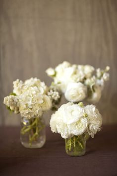 All-white wedding centerpieces. Camilla Svensson Burns Couture Floral. Allyson Magda Photography.