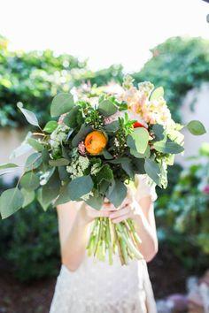bouquet filled with eucalyptus, photo by Chris Wojdak http://ruffledblog.com/casino-san-clemente-wedding-inspiration #weddingbouquet #flowers