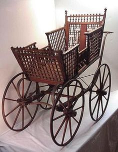 This Oak Victorian Carriage was made by J. B. Sweet  Son Mfg. Co. Buffalo, N. Y. maker of Childrens Carriages. It probably dates around the 1850s.    The Carriage appears to have its   original finish, and is built with   suspension springs to provide a smooth ride. http://www.eyesecretssave45.com/amazing.html
