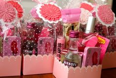 Girl's night out goodie bags - candy, mints, pink lemonade packets, lip gloss, manicure set, mini Smirnoff Ice's.  Cute idea.