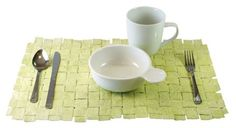 Eco friendly;Brown Bag Place Mat- cut 2 inch wide strips entire length of bag. fold down 1/4 inch on each side then fold in half and iron. weave into mat, paint or wax, seal with gloss ,edium- great for screened in porch.