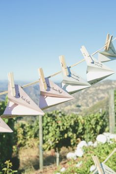 #EscortCards | Paper Airplanes | Onelove Photography | #SMP Weddings: http://www.stylemepretty.com/2013/12/04/travel-themed-wedding-at-saddlerock-ranch-from-onelove-photography/