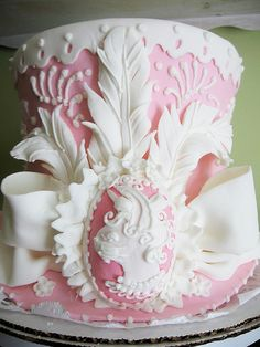 pink and white feathered decorative cake