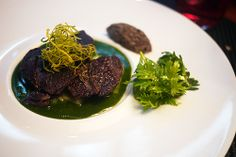 Braised beef cheek served with shungiku coulis flavored with mustard.
