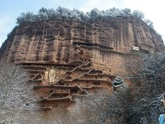 The Maijishan Grottoes are a series of 194 caves cut in the side of the hill of Majishan in Tianshui, Gansu Province, northwest China. View of the entire Maiji hill. cave, hous rock