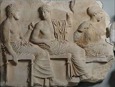 Acropolis Museum, Parthenon gallery, Greece. Detail of the east frieze (Block VI).   442-438 BC  Pheidias Workshop  A depiction of the gods Poseidon, Apollo and Aphrodite, on whose knees is perched a winged Eros. Two fragments are located in the British Museum and one fragment in Palermo.