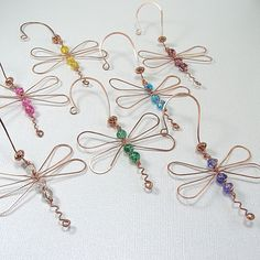 Dragonfly ornament copper green glass wire wrapped sun catcher garden art. $12.00, via Etsy.