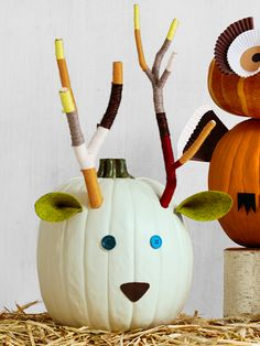 """Wrap tree branch """"antlers"""" with yarn for a colorful woodland creature."""