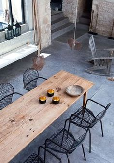 Timber table and black chairs