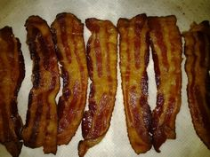 This is the big deal about oven bacon.  My stove top is clean and the bacon is flat.  I'm freezing all but 2 slices, they are for tonight's cheeseburger.  Line a cookie sheet with aluminium foil and place into a cold oven then turn on oven to 400 degrees bake for 17-20 minutes, my oven took 25.