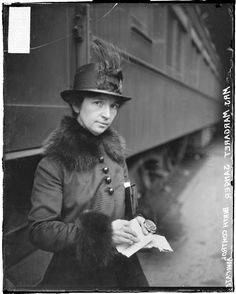 Birth control advocate, Margaret Sanger, standing next to a train in a station, 1917. DN-0067907.