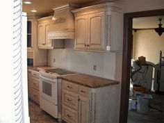 White washed ish on pinterest whitewash kitchen cabinets for White pickled kitchen cabinets