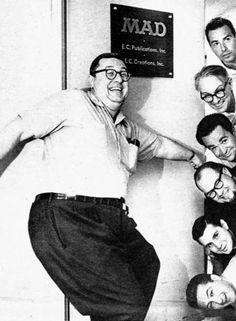 The Mad magazine staff [1963] (clockwise): publisher Bill Gaines, contributing editor Nick Meglin, art director John Putnam, editor Al Feldstein, Leonard Brenner (production), Nelson Tirado (subscriptions) and associate editor Jerry DeFuccio