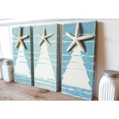 Set of three white washed Christmas Tree signs in shades of green, teal and blue - all topped with a natural bright white starfish....