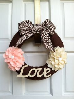 Brown and Pink Handmade Yarn Wreath with Felt Flowers and Love sign. $25.00, via Etsy.