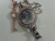 Origami Owl introduces: Lanyard, military charms and new Lock dangle.  Coming Aug. 18th. just click on the pic to order yours!