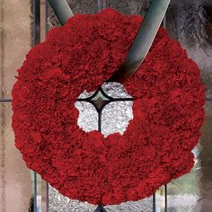 This wreath crafted from carnations is bold and beautiful.