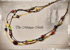 necklace of paper beads by Horse Wing, via Flickr