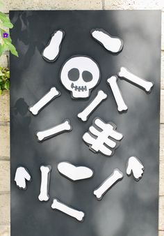 Clever! Kids Halloween Party: DIY Magnet Board! Wood board, magnet paint, paint roller, gloves, sand paper, black/white foam, knife, and round magnets.