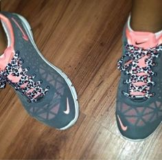 Pink and gray nikes with cheetah print laces.