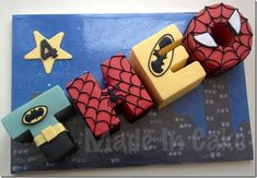 Great Batman and Spider-Man Cake by: between the pages blog