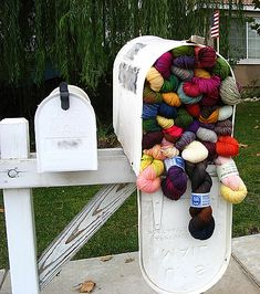 A mailbox full of yarn.  This has to be the ultimate dream for knitters and crocheters.  Imagine all the free knitting patterns I could start working on!