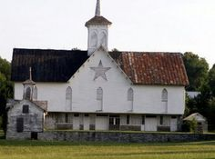 The old Star Barn looks more like an old church than an old barn because of the spired cupola.  The star actually acted as a vent to help dry out the stored grain.
